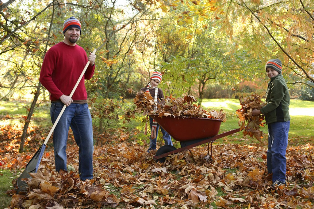 family practicing waste management and recycling leaves