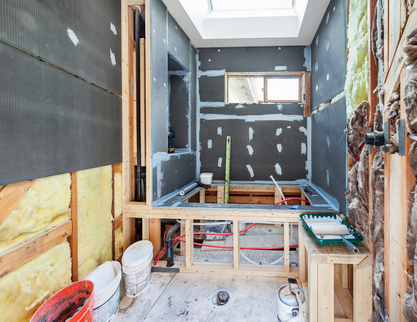 trash removal during residential remodel gray walls