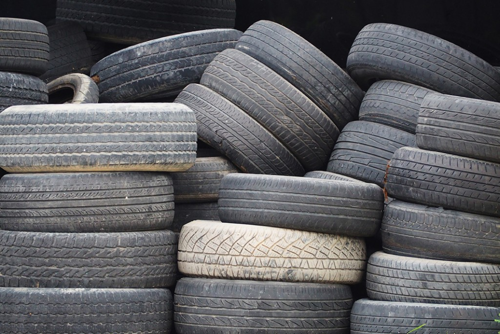 Proper trash removal needed for a pile of old tires